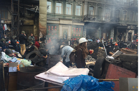 Protesters manning a barricade in downtown Kiev outside the apartment of Mihail Solomonovich, an 82-year-old recipient of aid from JDC who has been homebound since deadly clashes began last week; courtesy JDC.