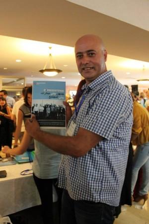Ahmad Sheikh Muhammad, Arab Community Programs Director at PresenTense, with Launch Night program booklet; photo courtesy PresenTense Israel.