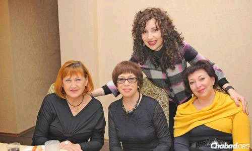 Chana Gopin (standing), with friends at a Chanukah activity in Lugansk.