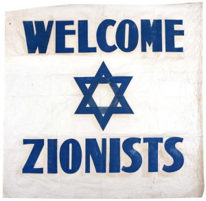 """ZIONIST FLAG, 1942. """"Welcome Zionists."""" English-language flag used at an international Zionist meeting at the Biltmore Hotel in New York City, May 6-11, 1942."""