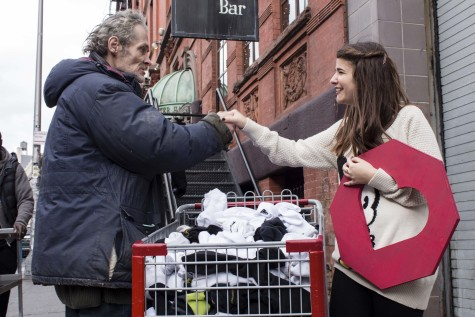 Adina Lichtman handing out socks to those in need