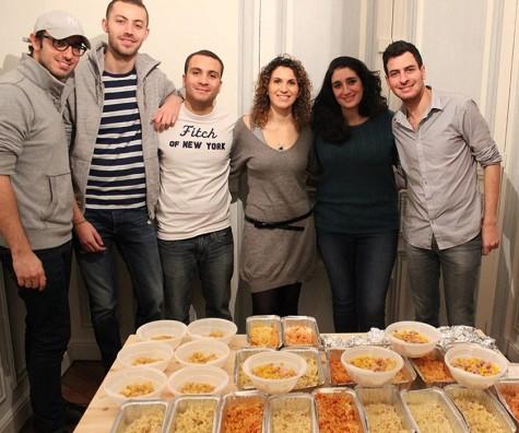 Moishe House Paris residents prepare food for their Tikkun Olam program.