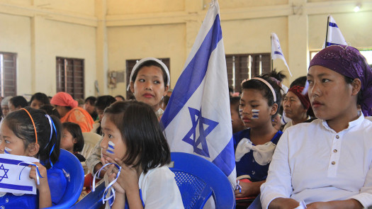 More than 1,500 members of the Bnei Menashe Lost Tribe, including these women and children, celebrate Israel Independence Day in Churachandpur, India. Photo Credit: Tzvi Khaute, Courtesy of Shavei Israel.