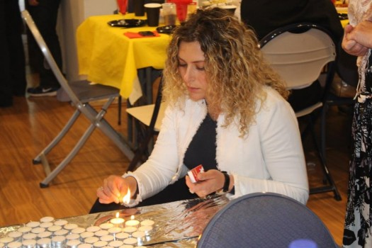 Ilona Blomberg lighting Shabbat candles; photo courtesy.