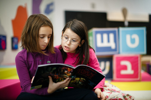 Russian-speaking Jewish children enjoy reading a book from PJ Library's new Russian-language program launching in Moscow this week. Photo courtesy of PJ Library.