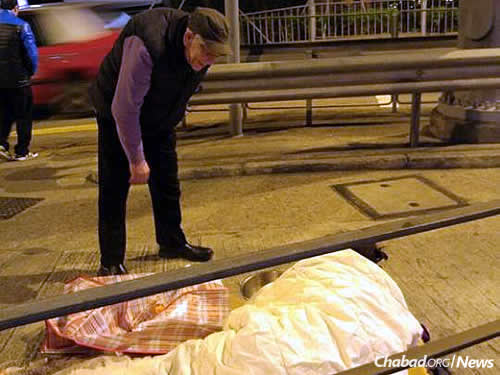Making sure those hunkered down on Hong Kong's streets had a blanket for warmth. Photo courtesy Chabad.org/News.