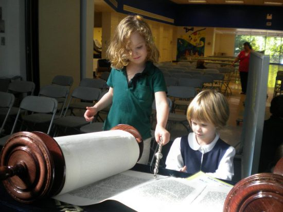 two girls -read- from Torah