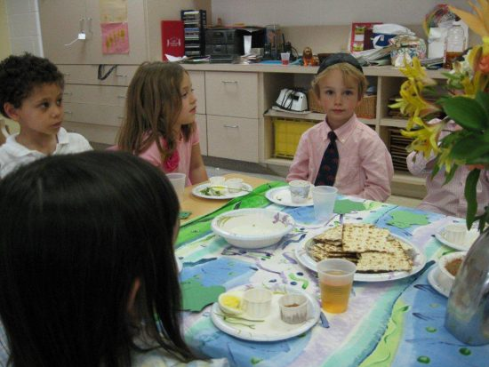 children seated at seder table