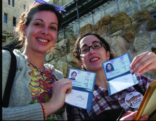 Two French olim proudly showing their new Israeli ID cards. Photo courtesy The Jewish Agency.