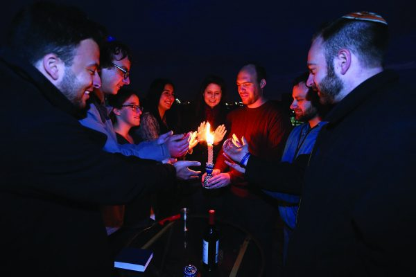 Moishe House Baltimore residents and community members come together for Havdalah on their rooftop. Photo courtesy Moishe House.