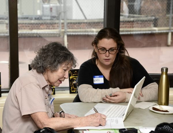 (Wire the Wise): Sandra, a wise, learns from Keren, a wired, how to manage her cellular account at our event in Manhattan, New York City.